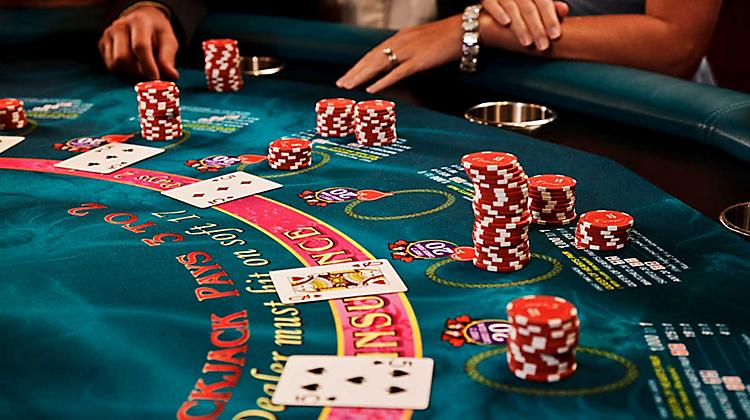 blackjack-table-card-game-players-and-chips-onboard-things-to-do-casino