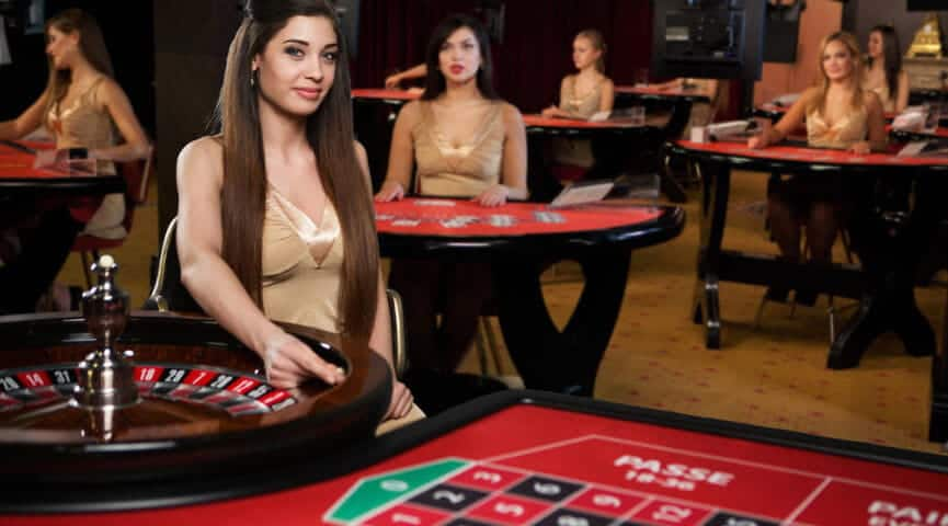 roulette dealers sitting on their tables