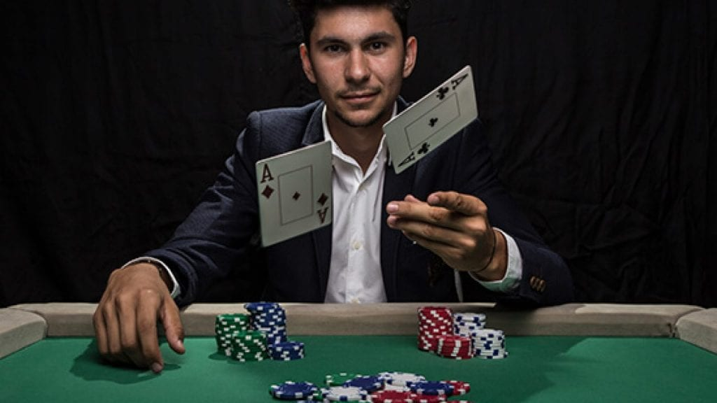 a man throwing casino cards in the air