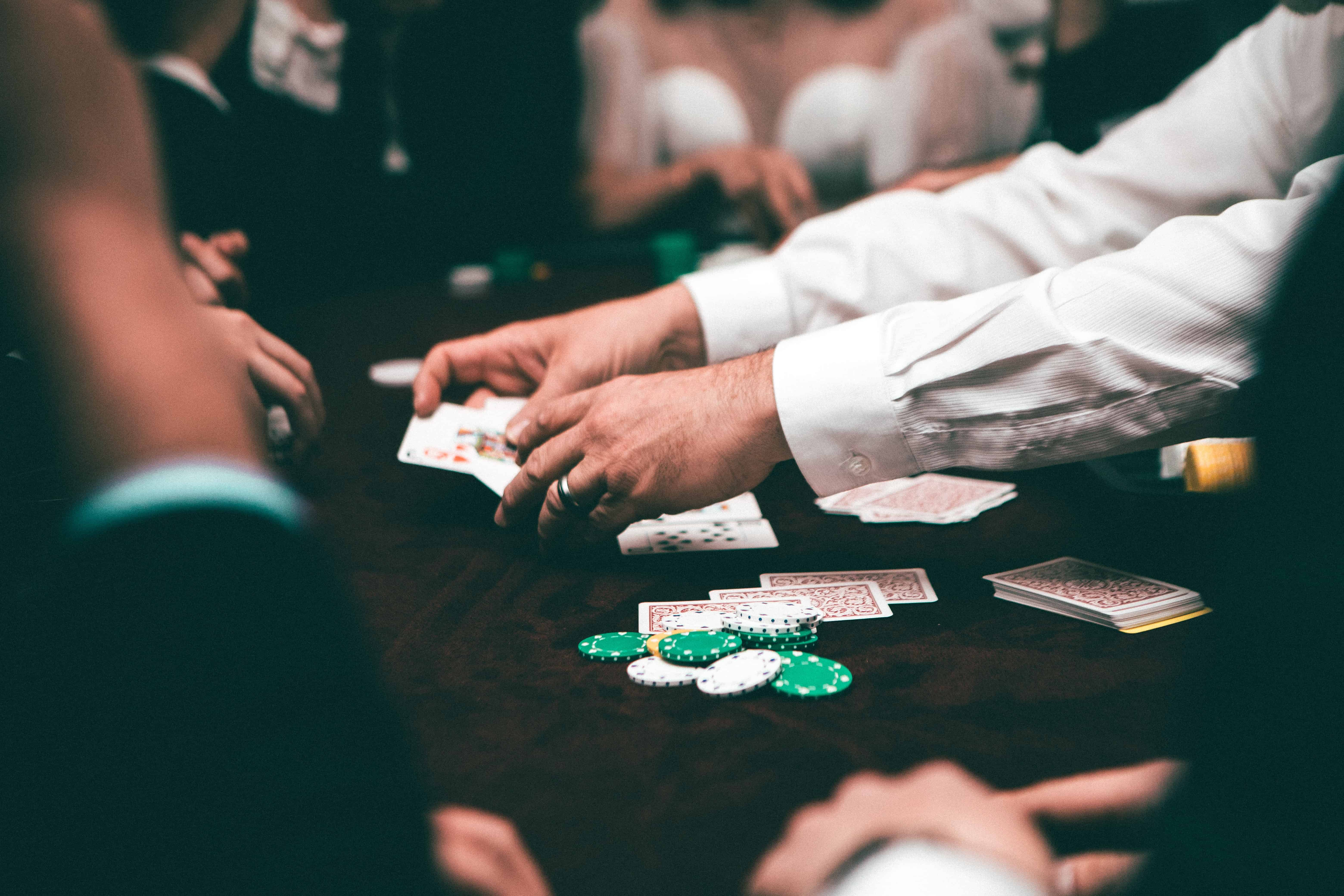 male hands holding casino cards