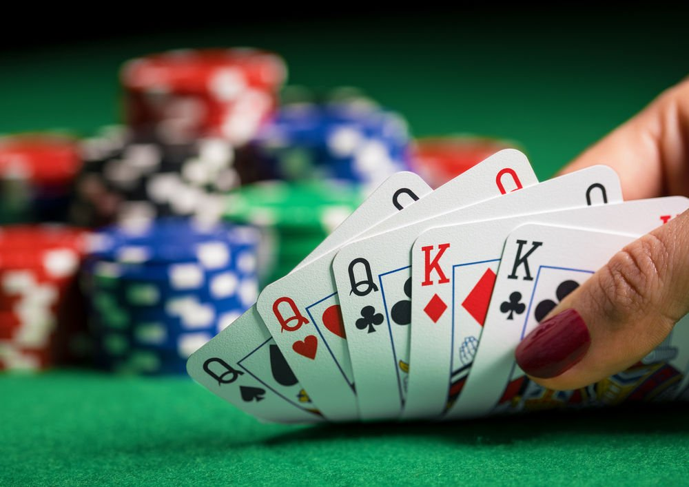 poker table with cards and chips